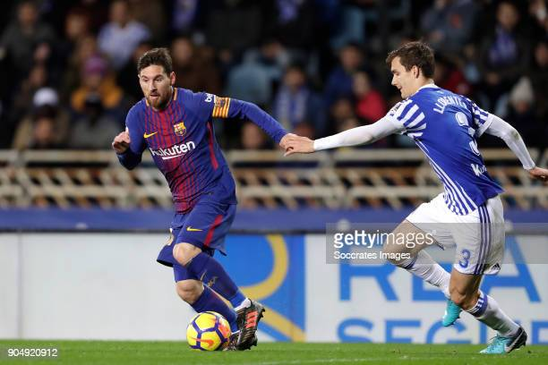 Lionel Messi of FC Barcelona Diego Llorente of Real Sociedad during the La Liga Santander match between Real Sociedad v FC Barcelona at the Estadio...