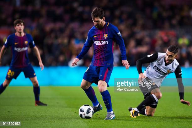 Lionel Messi of FC Barcelona dribbles Andreas Pereira of Valencia CF during the Copa del Rey semifinal first leg match between FC Barcelona and...