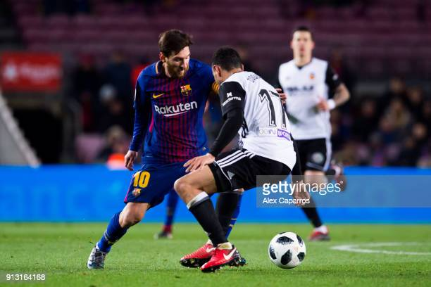 Lionel Messi of FC Barcelona dribbles Francis Coquelin of Valencia CF during the Copa del Rey semifinal first leg match between FC Barcelona and...