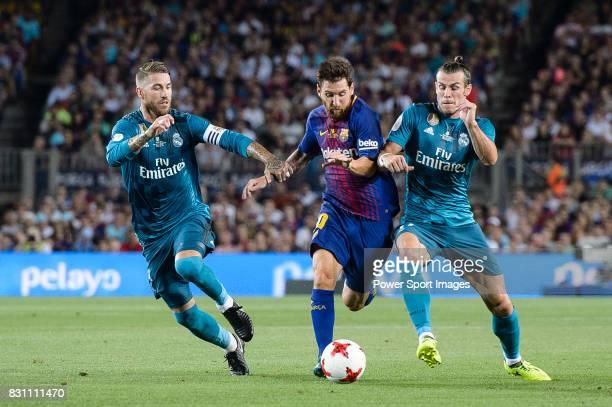 Lionel Messi of FC Barcelona dribbles Gareth Bale and Sergio Ramos of Real Madrid during the Supercopa de Espana Final 1st Leg match between FC...