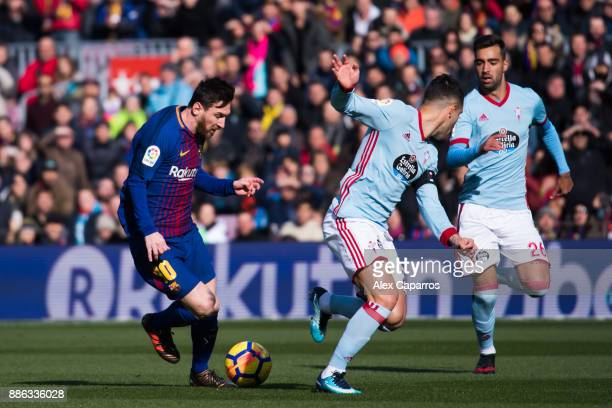 Lionel Messi of FC Barcelona dribbles Hugo Mallo of Celta de Vigo during the La Liga match between FC Barcelona and Celta de Vigo at Camp Nou on...