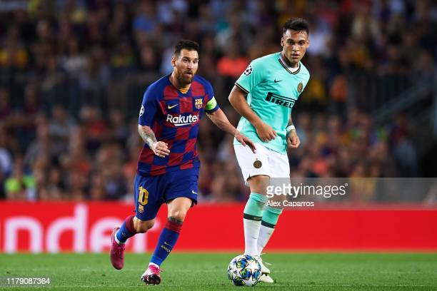 Lionel Messi of FC Barcelona dribbles Lautaro Martinez of Inter during the UEFA Champions League group F match between FC Barcelona and Inter at Camp...