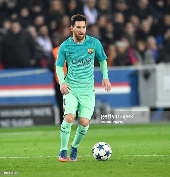 Lionel Messi of FC Barcelona drives the ball during the UEFA Champions League round of 16 match between Paris SaintGermain and FC Barcelona at Parc...