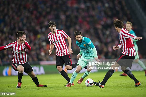 Lionel Messi of FC Barcelona duels for the ball with Ander Iturraspe of Athletic Club during the Copa del Rey Round of 16 first leg match between...