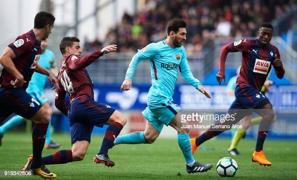 Lionel Messi of FC Barcelona duels for the ball with Daniel Garcia of SD Eibar during the La Liga match between SD Eibar and FC Barcelona at Ipurua...