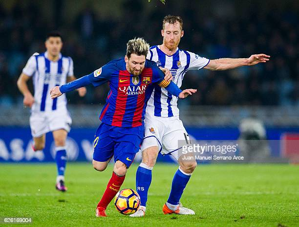 Lionel Messi of FC Barcelona duels for the ball with David Zurutuza of Real Sociedad during the La Liga match between Real Sociedad de Futbol and FC...