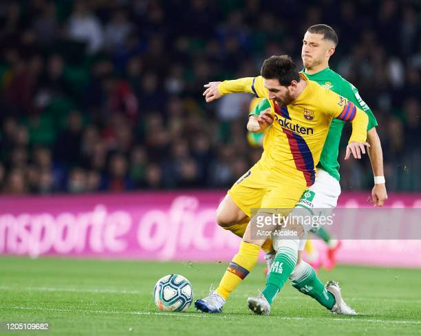 Lionel Messi of FC Barcelona duels for the ball with Guido Rodriguez of Real Betis Balompie during the Liga match between Real Betis Balompie and FC...