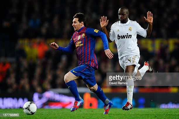 Lionel Messi of FC Barcelona duels for the ball with Lass Diarra of Real Madrid during the Copa del Rey quarter final second leg match between FC...