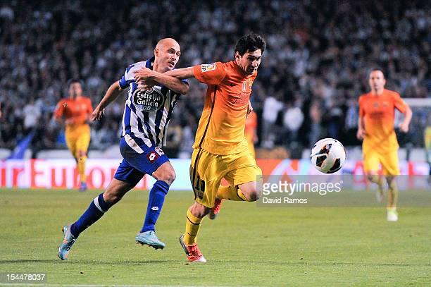 Lionel Messi of FC Barcelona duels for the ball with Laureano Sanabria of Deportivo La Coruna during the La Liga match between Deportivo La Coruna...