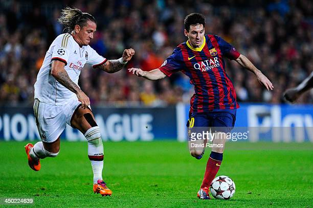 Lionel Messi of FC Barcelona duels for the ball with Philippe Mexes of AC Milan during the UEFA Champions League Group H match Between FC Barcelona...