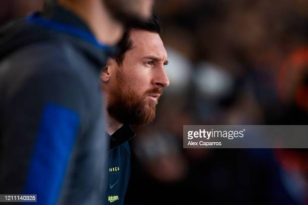 Lionel Messi of FC Barcelona enters the pitch before the Liga match between FC Barcelona and Real Sociedad at Camp Nou on March 07 2020 in Barcelona...