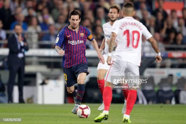 Lionel Messi of FC Barcelona Ever Banega of Sevilla FC during the La Liga Santander match between FC Barcelona v Sevilla at the Camp Nou on October...