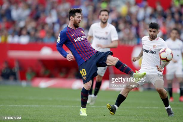 Lionel Messi of FC Barcelona Ever Banega of Sevilla FC during the La Liga Santander match between Sevilla v FC Barcelona at the Estadio Ramon Sanchez...