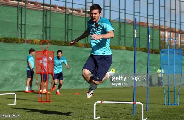 Lionel Messi of FC Barcelona exercises during the training session at Ciutat Esportiva on May 5 2014 in Barcelona Spain