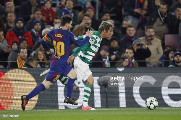 Lionel Messi of FC Barcelona Fabio Coentrao of Sporting Club de Portugal during the UEFA Champions League group D match between FC Barcelona and...