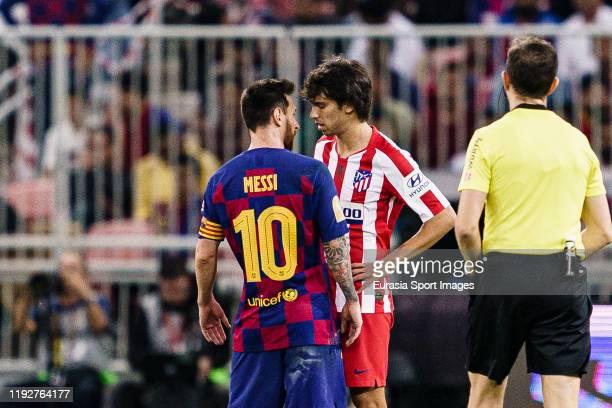 Lionel Messi of FC Barcelona faces Joao Felix of Atletico de Madrid during the Supercopa de Espana SemiFinal match between FC Barcelona and Club...
