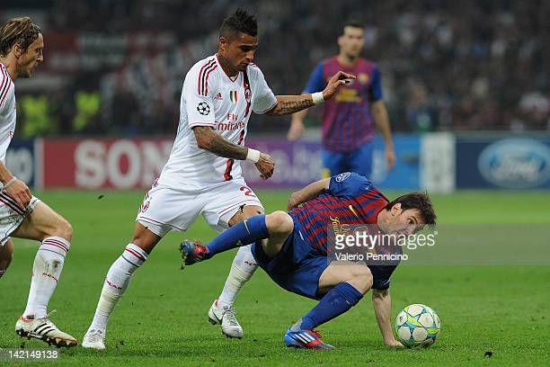 Lionel Messi of FC Barcelona falls in a challenge with KevinPrince Boateng of AC Milan during the UEFA Champions League quarter final first leg match...