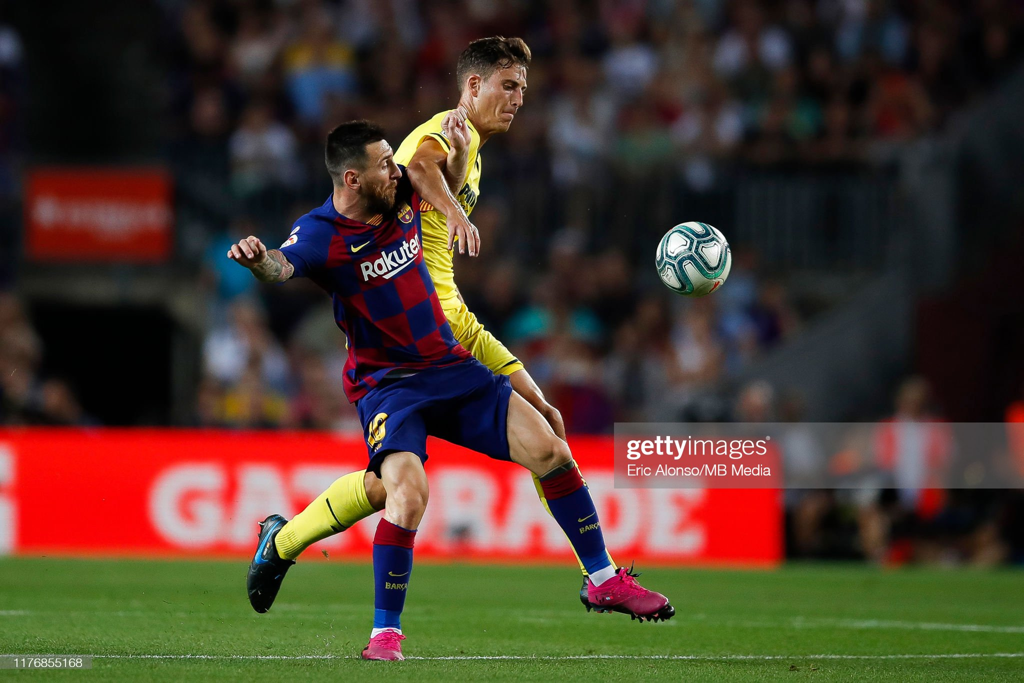 صور مباراة : برشلونة - فياريال 2-1 ( 24-09-2019 )  Lionel-messi-of-fc-barcelona-fight-for-the-ball-against-pau-torres-of-picture-id1176855168?s=2048x2048