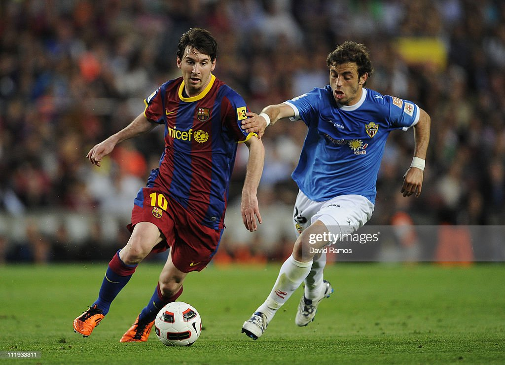 Lionel Messi of FC Barcelona (L) fights for the ball against Hernan Bernardello of Almeria during the La Liga match between FC Barcelona and UD Almeria at Camp Nou on April 9, 2011 in Barcelona, Spain.