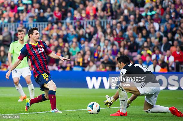 Lionel Messi of FC Barcelona fights for the ball with Andres Fernandez of CA Osasuna during the La Liga match between FC Barcelona and CA Osasuna at...