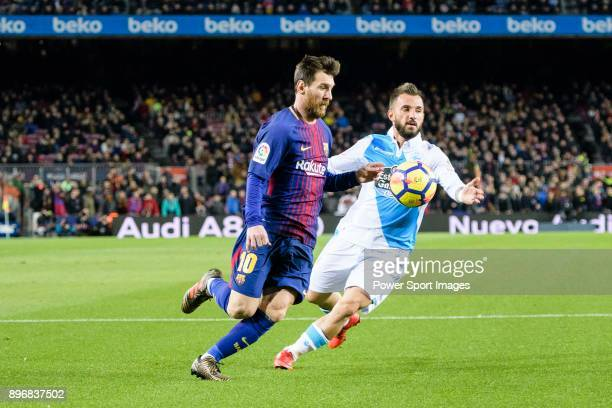 Lionel Messi of FC Barcelona fights for the ball with Emre Colak of RC Deportivo La Coruna during the La Liga 201718 match between FC Barcelona and...