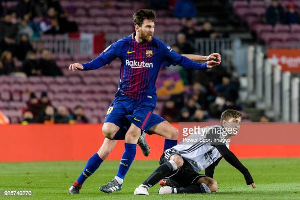 Lionel Messi of FC Barcelona fights for the ball with Luciano Vietto of Valencia CF during the Copa Del Rey 201718 match between FC Barcelona and...