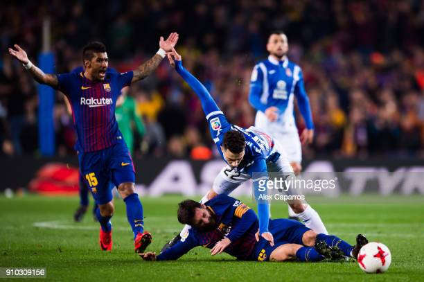Lionel Messi of FC Barcelona fights for the ball with Mario Hermoso of RCD Espanyol during the Spanish Copa del Rey Quarter Final Second Leg match...