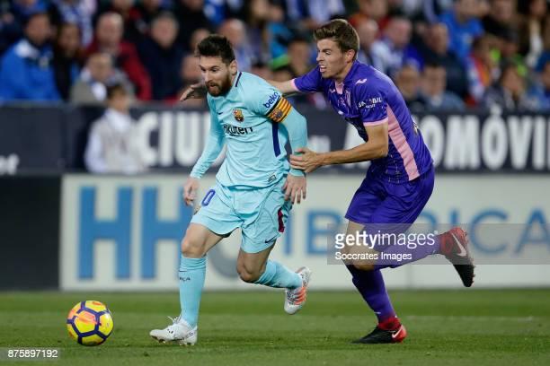Lionel Messi of FC Barcelona Gerard of Leganes during the Spanish Primera Division match between Leganes v FC Barcelona at the Estadio Municipal de...