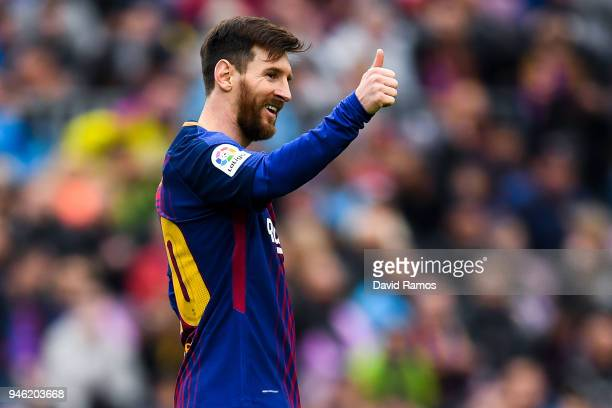 Lionel Messi of FC Barcelona gives his thumbs up during the La Liga match between Barcelona and Valencia at Camp Nou on April 14 2018 in Barcelona...