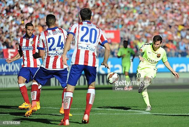 Lionel Messi of FC Barcelona has a shot at goal during the La Liga match between Club Atletico de Madrid and FC Barcelona at Vicente Calderon Stadium...