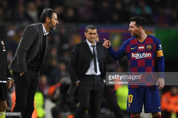 Lionel Messi of FC Barcelona has words with Vicente Moreno Head Coach of RCD Mallorca during the Liga match between FC Barcelona and RCD Mallorca at...
