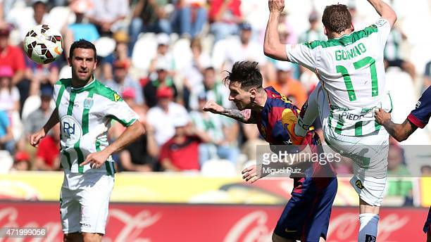 Lionel Messi of FC Barcelona heads the ball during the La Liga match between Cordoba CF and FC Barcelona at Nuevo Arcange on May 2 2015 in Cordoba...