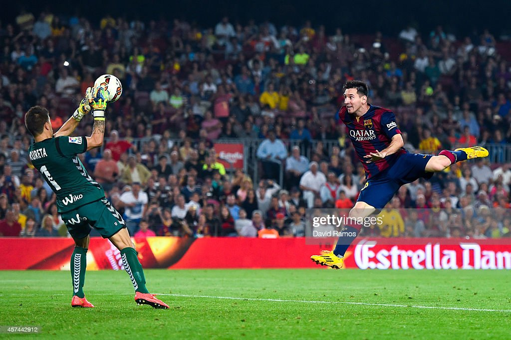Lionel Messi of FC Barcelona heads the ball under a challenge by Xabi Irureta of SD Eibar during the La Liga match between FC Barcelona and SD Eibar at Camp Nou on October 18, 2014 in Barcelona, Spain.