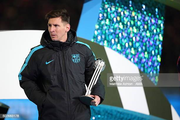 Lionel Messi of FC Barcelona holding the Adidas Silver Ball Trophy during the FIFA Club World Cup Final Match between FC Barcelona and River Plate at...