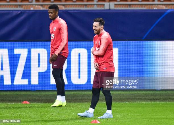 Lionel Messi of FC Barcelona holds his arm during a FC Barcelona press conference and training session at San Siro Stadium on November 5 2018 in...