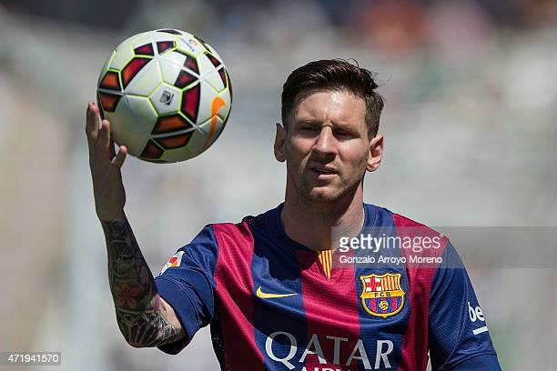 Lionel Messi of FC Barcelona holds the ball during the La Liga match between Cordoba CF and Barcelona FC at El Arcangel stadium on May 2 2015 in...