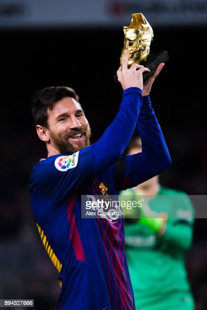 Lionel Messi of FC Barcelona holds the Golden Boot trophy ahead of the La Liga match between FC Barcelona and Deportivo La Coruna at Camp Nou on...