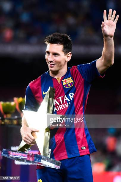 Lionel Messi of FC Barcelona holds the MVP trophy at the end of the Joan Gamper Trophy match between FC Barcelona and Club Leon at Camp Nou on August...