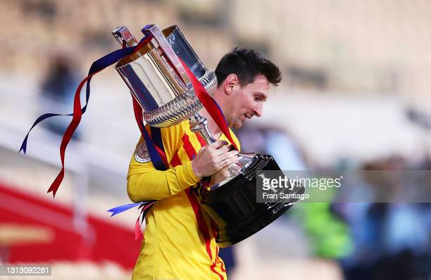Lionel Messi of FC Barcelona holds the trophy after winning the Copa del Rey Final match between Athletic Club and Barcelona at Estadio de La Cartuja...