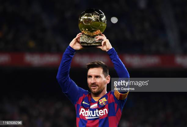 Lionel Messi of FC Barcelona holds up his sixth Ballon d'Or prior to the Liga match between FC Barcelona and RCD Mallorca at Camp Nou on December 07...