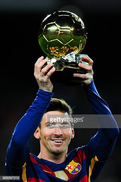 Lionel Messi of FC Barcelona holds up the FIFA Ballon d'Or trophy prior to the La Liga match between FC Barcelona and Athletic Club de Bilbao at Camp...