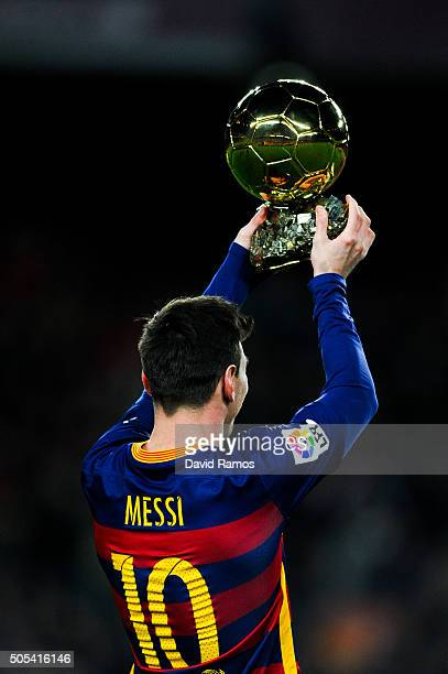 Lionel Messi Of FC Barcelona Holds Up The FIFA Ballon DOr Trophy Prior To