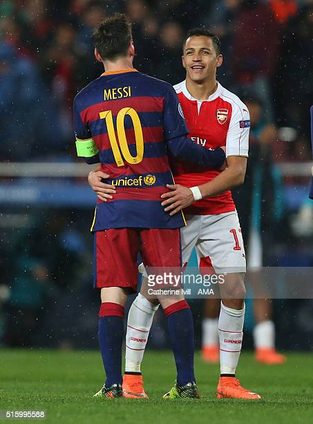 Lionel Messi of FC Barcelona hugs Alexis Sanchez of Arsenal at the end during the UEFA Champions League match between FC Barcelona and Arsenal at...