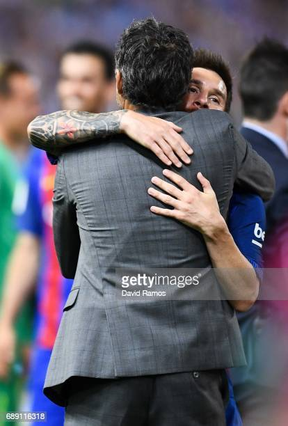 Lionel Messi of FC Barcelona hugs Head coach Luis Enrique of FC Barcelona after winning the Copa Del Rey Final between FC Barcelona and Deportivo...