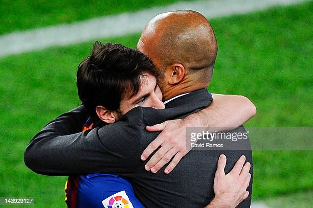 Lionel Messi of FC Barcelona hugs his Head coach Josep Guardiola of FC Barcelona after scoring his team's third goal during the La Liga match between...