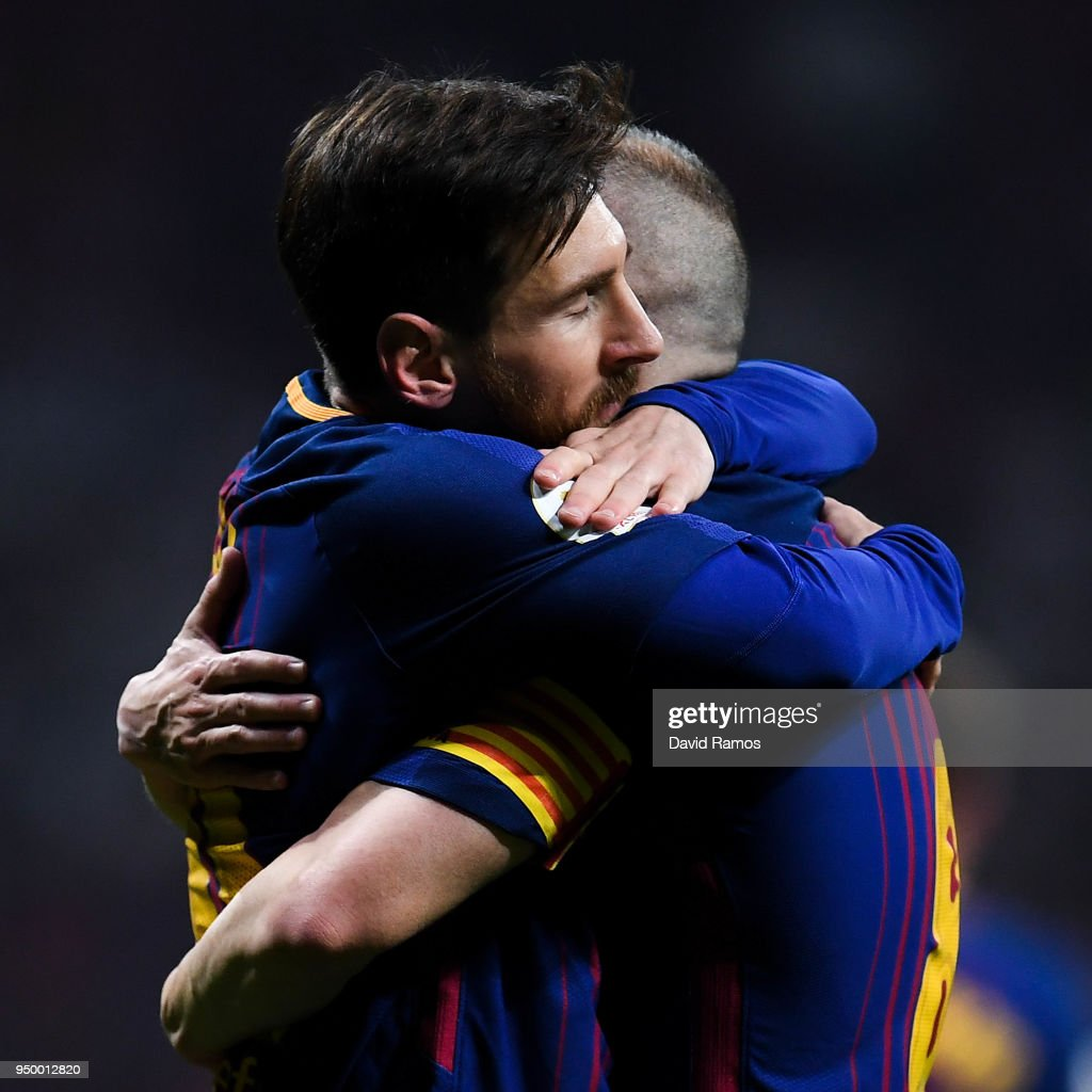Lionel Messi of FC Barcelona hugs his team mate Andres Iniesta of FC Barcelona after Iniesta scored his team's fourth goal during the Spanish Copa del Rey Final match between Barcelona and Sevilla at Wanda Metropolitano stadium on April 21, 2018 in Barcelona, Spain.