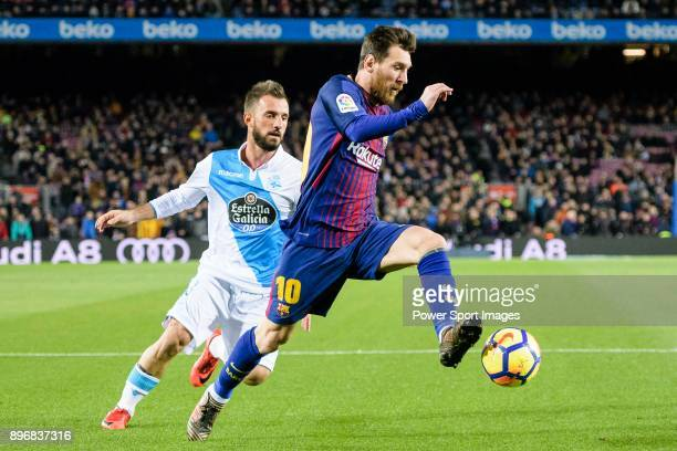 Lionel Messi of FC Barcelona in action against Emre Colak of RC Deportivo La Coruna runs with the ball during the La Liga 201718 match between FC...