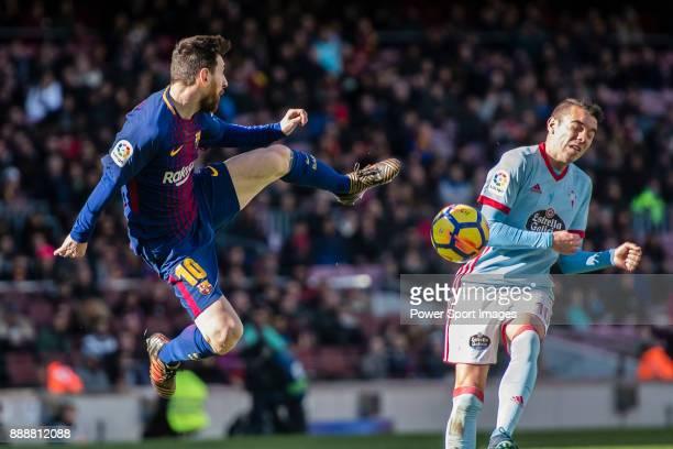 Lionel Messi of FC Barcelona in action against Iago Aspas Juncal of RC Celta de Vigo during the La Liga 201718 match between FC Barcelona and RC...