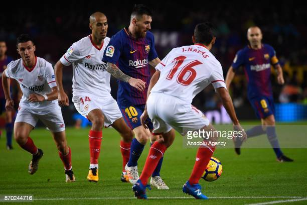 Lionel Messi of FC Barcelona in action against Jesus Navas of Sevilla FC during the Spanish league football match between FC Barcelona and Sevilla FC...