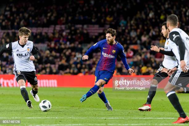 Lionel Messi of FC Barcelona in action against Luciano Vietto of Valencia CF during the Copa Del Rey 201718 match between FC Barcelona and Valencia...